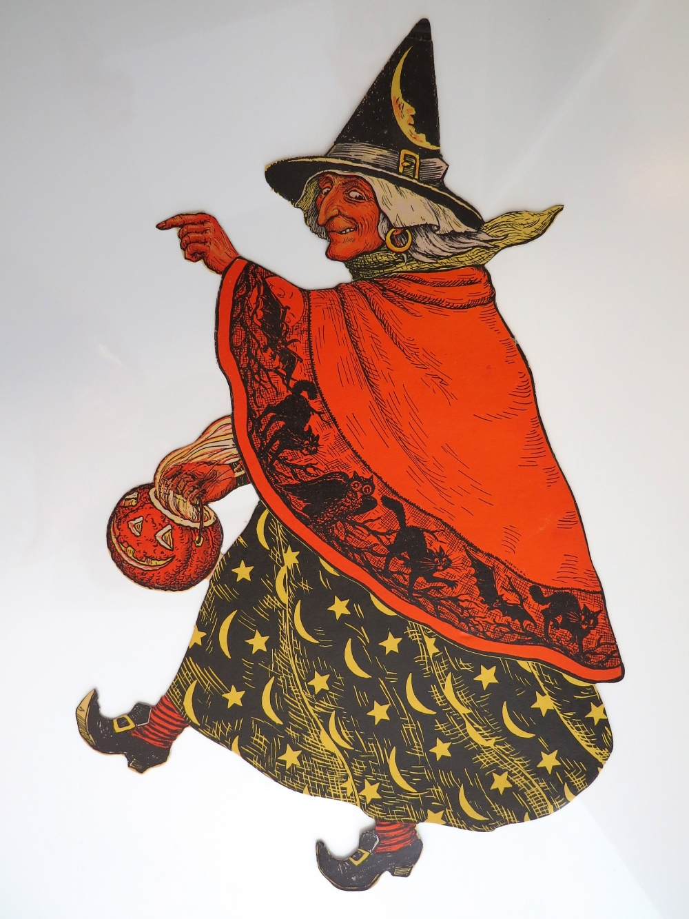 Walking witch carrying a JOL, USA, Beistle, (no mark), mid-1930s, 23